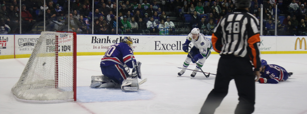 Canucks Send Four to Comets