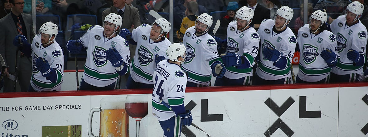 BOUCHER, BACHMAN POWER COMETS TO WIN OVER WOLF PACK
